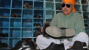 Pakistani official Khurshid Khan said he polished shoes as penance for Taliban crimes