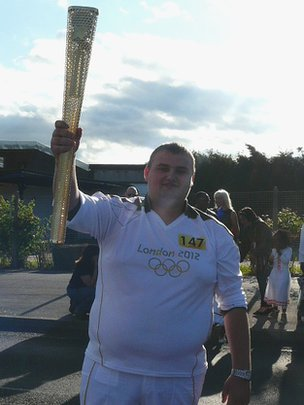 Aidan Dixon with the Olympic torch
