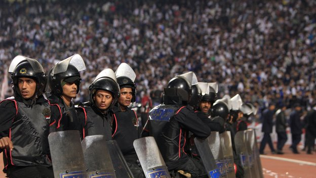 Riot police monitor an Egyptian football match