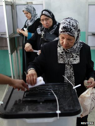 Women cast their vote at a polling station in Cairo
