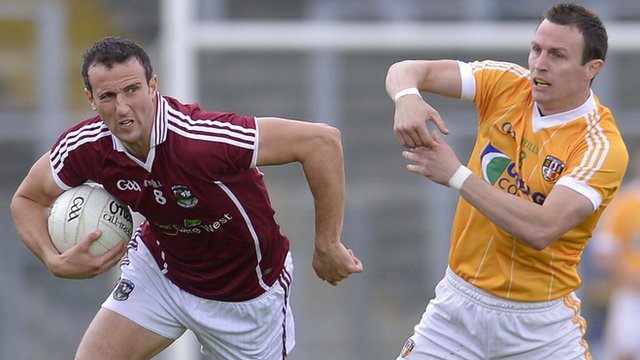 Michael McCann (right) battles with Galway's Joe Bergin at Casement Park on Saturday