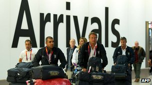 Members of Italy's Olympic shooting team arrive at Heathrow