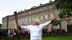 Sara Tremlett holding the Olympic Flame at Petworth House
