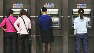 People withdraw money from ATMs in Chongqing