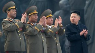 File photo of North Korean leader Kim Jong-un with North Korea's then-army chief Ri Yong-ho (2nd L) and other senior members of the military