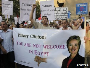Protesters chant slogans against the visit of US Secretary of State Hillary Clinton near the US Embassy in Cairo