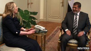 Egypt's first Islamist President Mohamed Mursi (R) meets US Secretary of State Hillary Clinton