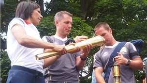 Dame Kelly Holmes lighting the torch at Tonbridge Castle