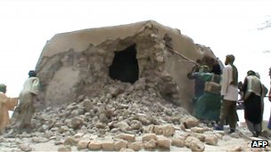 A still from a video shows Islamist militants destroying an ancient shrine in Timbuktu on July 1, 2012