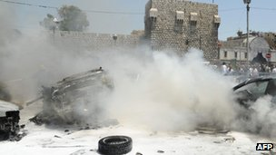 Smoke fills the air at the scene of two huge bomb explosions outside the Palace of Justice in Central Damascus on June 28, 2012.