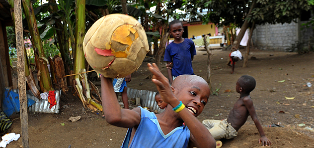 Boy plays with a football in Malabo