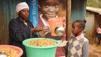 A pupil at Makina Self-Help Primary School receives her free meal