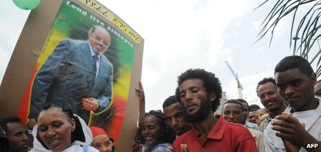 People celebrate with a poster Prime Minister Mele Zenawi's the Ethiopian People's Revolutionary Front (EPRDF)'s 20 years in power - 28 May 2011