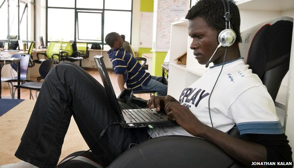 A man uses a laptop at iHub in Kenya