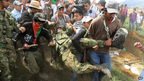 Nasa Indians drag a soldier down Berlin mountain in Cauca province