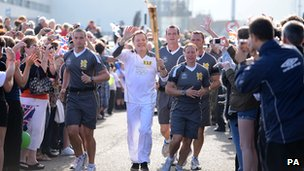 Eddie Izzard with the flame