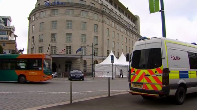 Hilton Hotel and police van