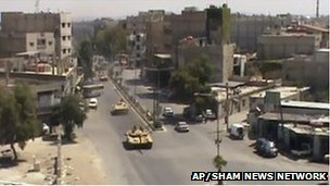 Pictures activists claim show tanks on Damascus&#039;s streets