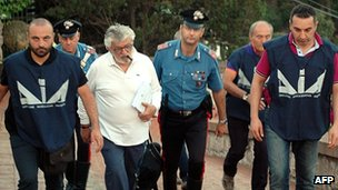 Giuseppe Mandara, in white, is led away by police in an image released by police on 17 July 2012