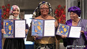 Nobel laureates President Johnson Sirleaf (R), peace activist Leymah Gbowee (C) and Yemeni activist Tawakkol Karman (L) 