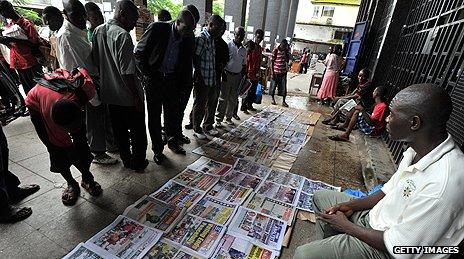 Newspaper vendor in Monrovia