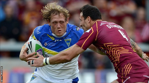 Warrington's Ben Westwood is tackled by Lee Gilmour of Huddersfield