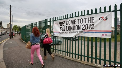 "Prospective G4S employees arrive at their ""London 2012 Recruitment and Training Centre"" near the Olympic Park site on 17 July"