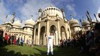Zachary Narvaez holds the torch aloft at Brighton's Royal Pavilion