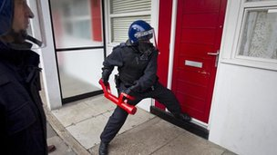 Generic police breaking down door