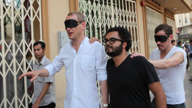 A blindfolded Christian Jankowski is shown around Dubai by Rami Farook