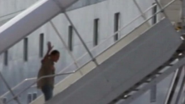 Luis Vladimir Vega boarding a ferry