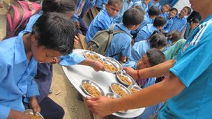 Pupils receive school lunches in Dalla, Nepal