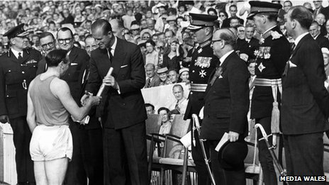 Ken Jones hands the baton containing the Queen's message to the Duke of Edinburgh at the opening ceremony of the British Empire and Commonwealth Games, Cardiff Arms Park, 1958. ONE USE ONLY AGREED WITH ROB NORMAN