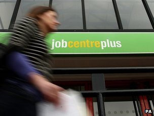 Woman walks past a Job Centre