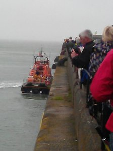 RNLI boat with flame