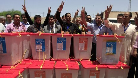High Election Commission workers chant the national anthem behind ballot boxes which just arrived from the region of Kufra, at the High Election Commission Centre in Tripoli - 12 July 2012