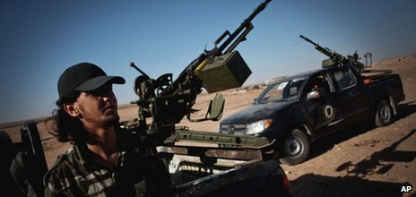 A Libyan militiaman stands at a check point near the border of Bani Walid in Misrata, Libya, Sunday, 15 July 2012