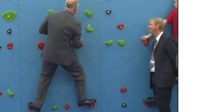 Prince Charles on a climbing wall