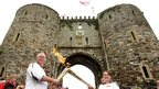 Jessica-Rose Gould passed the flame to Douglas Evans outside Rye Castle