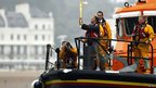 Torch security officer Sakira Suzia carried the flame on board an RNLI lifeboat after the official torch carrier Jamie Clark became seasick at Dover