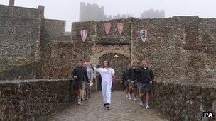 Sophie Waller carrying the Olympic Flame through Dover Castle