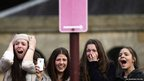 Teenage fans react as Canadian singer Justin Bieber performs in Sydney