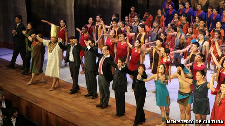 Cast members and officials take a bow after the performance of Akas Kas