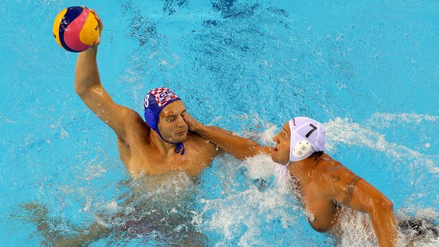 Hungarian and Croatian water polo players clash
