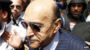 A picture taken on April 7, 2012 shows former Egyptian intelligence chief Omar Suleiman arriving at the presidential election committee building in Cairo