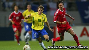 Juninho playing for Brazil in the 2002 World Cup