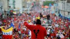 Hugo Chavez speaks to supporters during a campaign rally