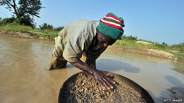 Man panning for diamonds in Sierra Leone