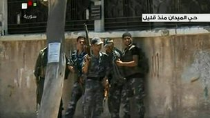 Image from video which Syrian official news agency Sana says troops fighting against rebels in the Midan area of Damascus 18/07/2012