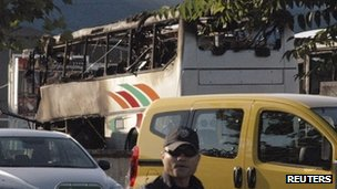 Burnt buses are seen at Bulgaria's Burgas airport July 18, 2012